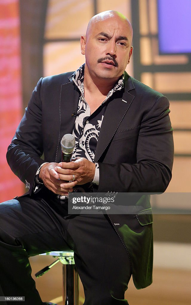<a gi-track='captionPersonalityLinkClicked' href=/galleries/search?phrase=Lupillo+Rivera&family=editorial&specificpeople=657839 ng-click='$event.stopPropagation()'>Lupillo Rivera</a> performs on the set of Telemundo's 'Un Nuevo Dia' at Telemundo Studio on September 9, 2013 in Miami, Florida.