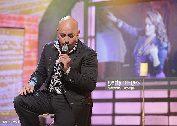 Lupillo Rivera performs on the set of Telemundo's 'Un Nuevo Dia' at Telemundo Studio on September 9 2013 in Miami Florida