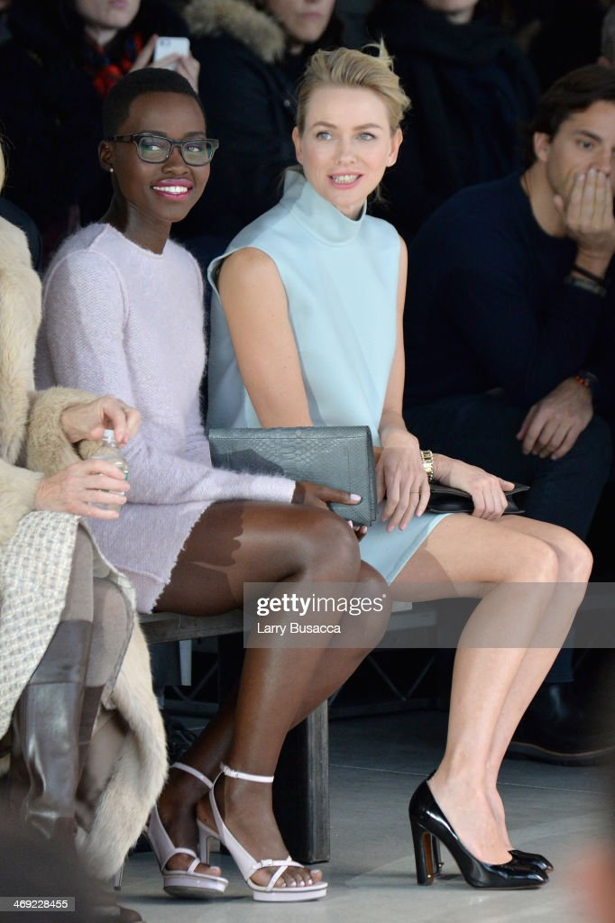 <a gi-track='captionPersonalityLinkClicked' href=/galleries/search?phrase=Lupita+Nyong%27o&family=editorial&specificpeople=10961876 ng-click='$event.stopPropagation()'>Lupita Nyong'o</a> and <a gi-track='captionPersonalityLinkClicked' href=/galleries/search?phrase=Naomi+Watts&family=editorial&specificpeople=171723 ng-click='$event.stopPropagation()'>Naomi Watts</a> attend the Calvin Klein Collection fashion show during Mercedes-Benz Fashion Week Fall 2014 at Spring Studios on February 13, 2014 in New York City.
