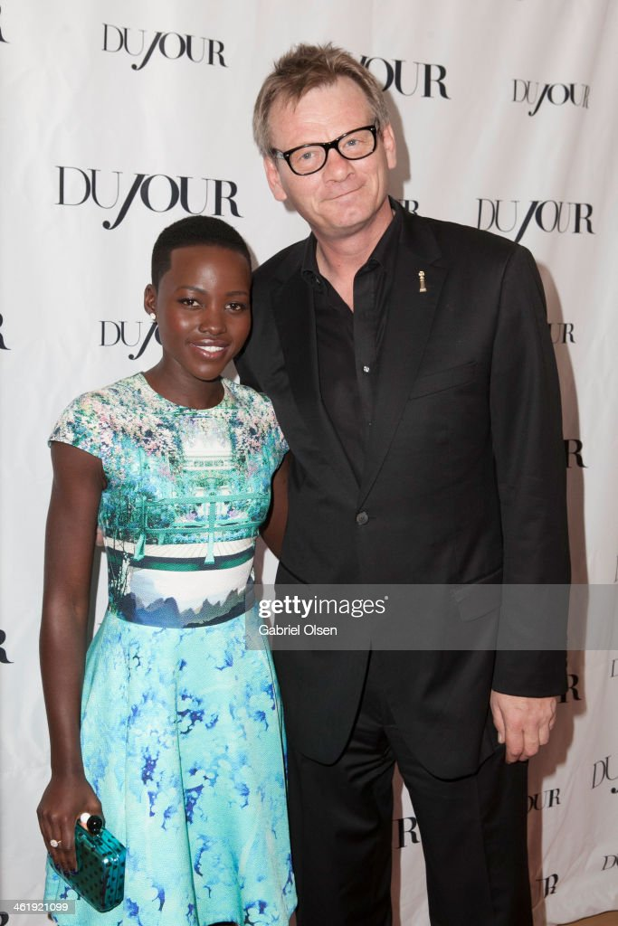 <a gi-track='captionPersonalityLinkClicked' href=/galleries/search?phrase=Lupita+Nyong%27o&family=editorial&specificpeople=10961876 ng-click='$event.stopPropagation()'>Lupita Nyong'o</a> and Theo Kingma arrive for DuJour Magazine's Jason Binn with editors Nicole Vecchiarelli & Keith Pollock as they celebrate The Great Performances issue featuring '12 Years A Slave' Golden Globe Nominee <a gi-track='captionPersonalityLinkClicked' href=/galleries/search?phrase=Lupita+Nyong%27o&family=editorial&specificpeople=10961876 ng-click='$event.stopPropagation()'>Lupita Nyong'o</a> at Herringbone, Mondrian LA on January 11, 2014 in Beverly Hills, California.