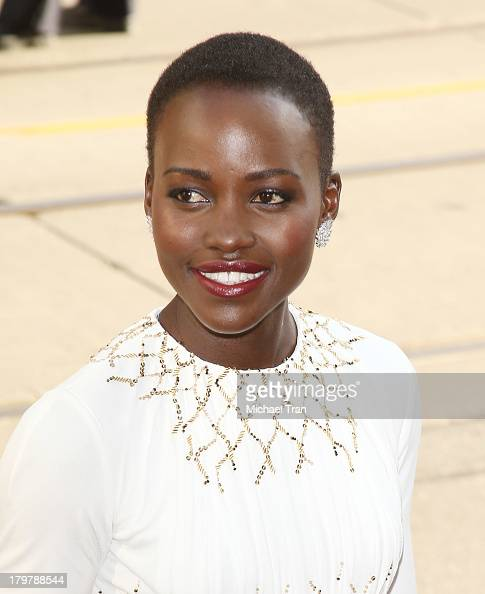 Lupita Nyong'o arrives at the '12 Years A Slave' premiere during the 2013 Toronto International Film Festival held at Princess of Wales Theatre on...