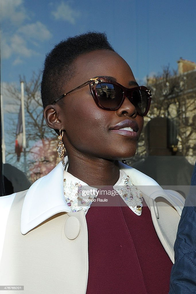 <a gi-track='captionPersonalityLinkClicked' href=/galleries/search?phrase=Lupita+Nyong%27o&family=editorial&specificpeople=10961876 ng-click='$event.stopPropagation()'>Lupita Nyong'o</a> arrives at the Miu Miu show as part of the Paris Fashion Week Womenswear Fall/Winter 2014-2015 on March 5, 2014 in Paris, France.