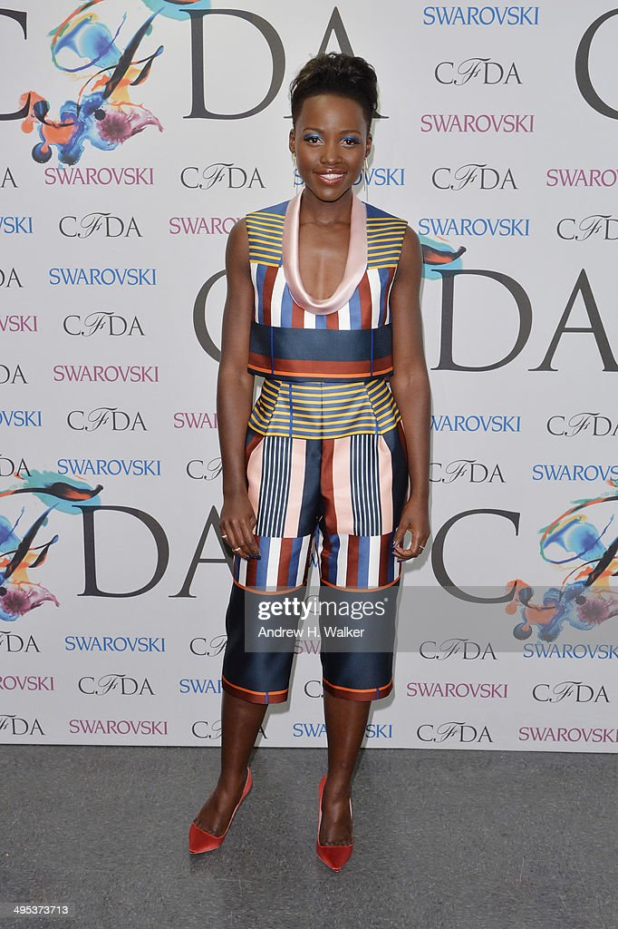 <a gi-track='captionPersonalityLinkClicked' href=/galleries/search?phrase=Lupita+Nyong%27o&family=editorial&specificpeople=10961876 ng-click='$event.stopPropagation()'>Lupita Nyong'o</a> attends the winners walk during the 2014 CFDA fashion awards at Alice Tully Hall, Lincoln Center on June 2, 2014 in New York City.
