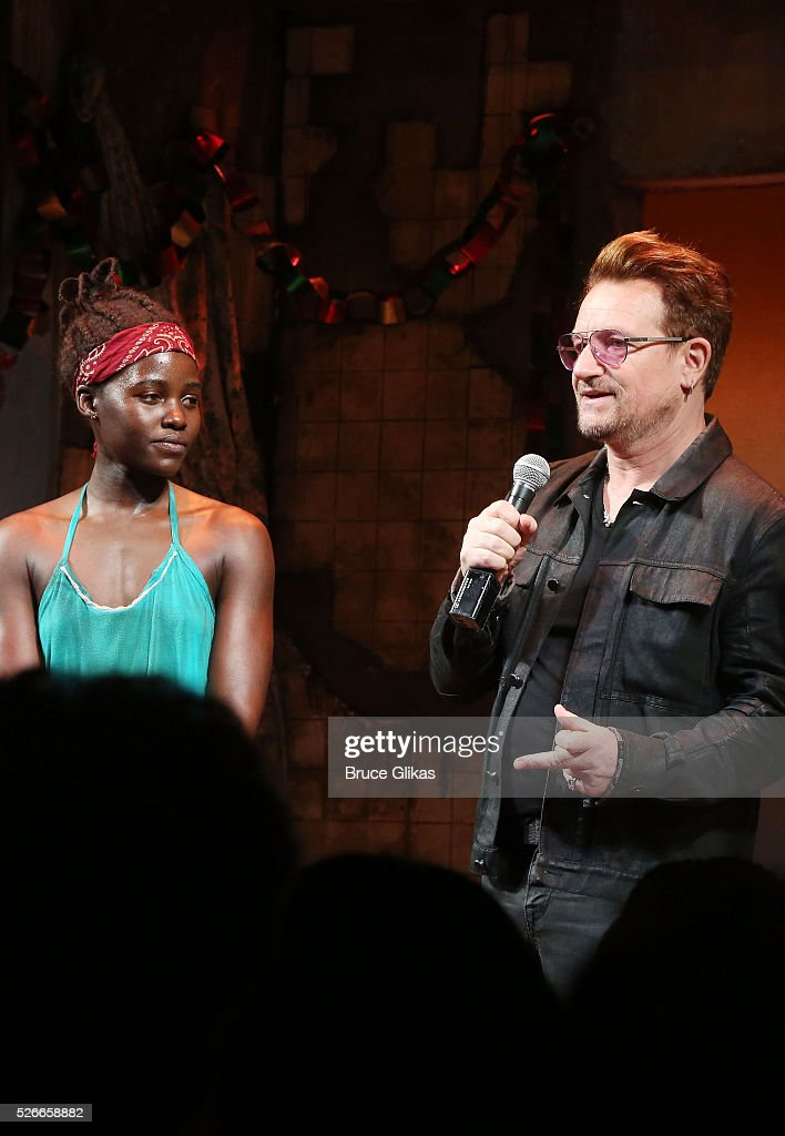 Lupita Nyong'o, Bono and the cast of Broadway's 'Eclipsed' onstage as Bono visits 'Eclipsed' to launch a dedication series in honor of abducted Chibok Girls of Northern Nigeriaon at The Golden Theatre on April 30, 2016 in New York, New York.