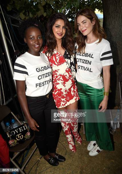 Lupita Nyong'o Priyanka Chopra and Michelle Monaghan pose backstage during the 2017 Global Citizen Festival in Central Park on September 23 2017 in...