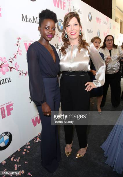 Lupita Nyong'o with Cathy Shulman attend the Women In Film 2017 Crystal Lucy Awards presented By Max Mara and BMW at The Beverly Hilton Hotel on June...