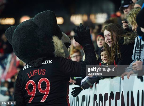 Lupus the FC Midtjylland wolf mascot shake hands with young fans during the Danish Alka Superliga match between FC Midtjylland and Lyngby BK at MCH...