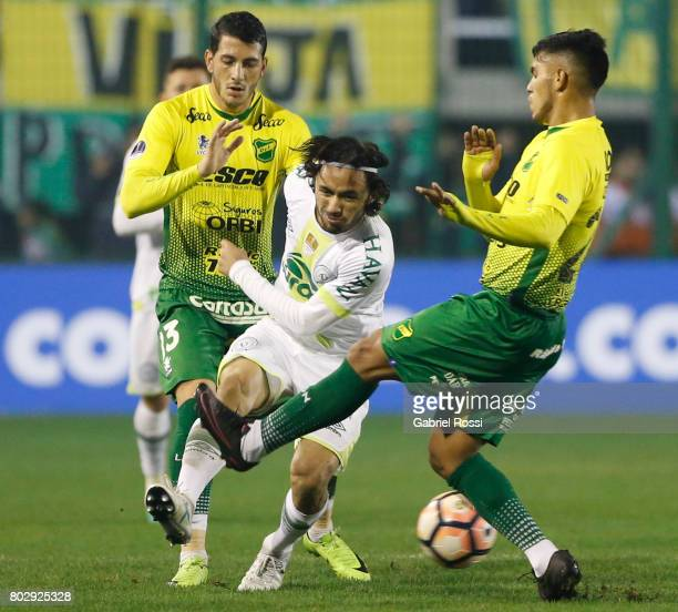 Luís Apodi of Chapecoense fights for the ball with Rafael Marcelo Delgado of Defensa y Justicia during a first leg match between Defensa y Justicia...