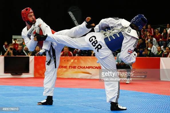 Lutalo Massop Muhammad of Great Britain and Damon Sansum of Great Britain compete in the Seniors Male A 80kg during the World Taekwondo Grand Prix...