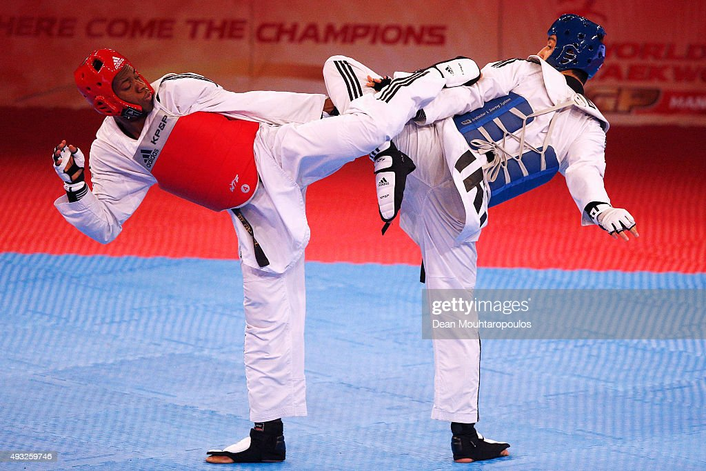 Lutalo Massop Muhammad of Great Britain and Mehdi Khodabakhshi of Iran compete in the Seniors Male A 80kg semi final during the World Taekwondo Grand...