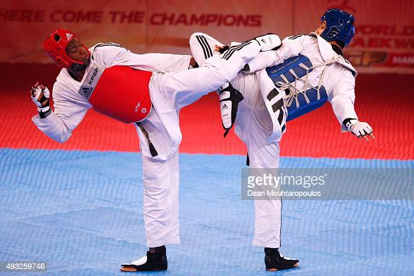 Lutalo Massop Muhammad of Great Britain and Mehdi Khodabakhshi of Iran compete in the Seniors Male A 80kg semi final during the World Taekwondo Grand...