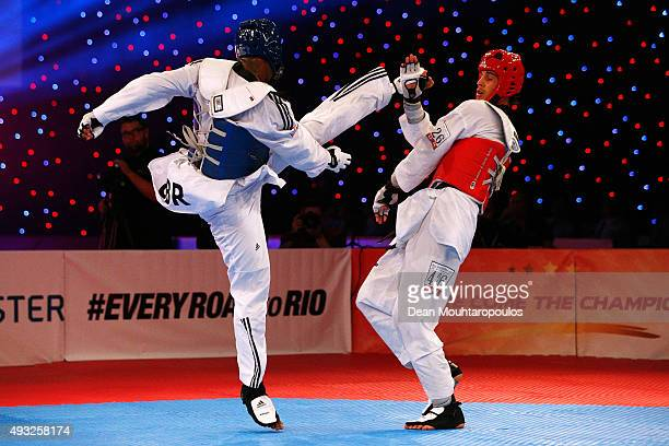 Lutalo Massop Muhammad of Great Britain and Oussama Oueslati of Tunisia compete in the Seniors Male A 80kg Gold Medal bout during the World Taekwondo...