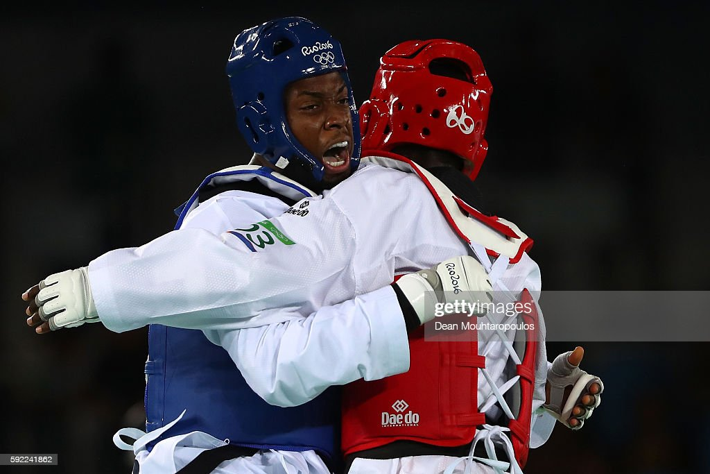 Lutalo Muhammad (L) of Great Britain competes against Cheick Sallah Cisse of Cote d'Ivoire in the Men's Taekwondo -80kg Gold Medal Contest on Day 14 of the Rio 2016 Olympic Games at Carioca Arena 3 on August 19, 2016 in Rio de Janeiro, Brazil.