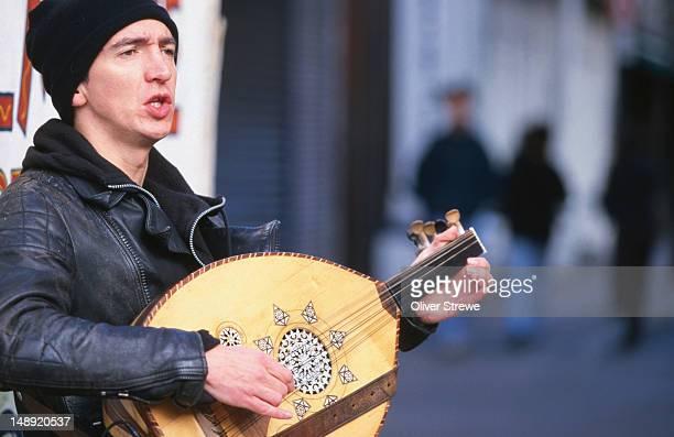 A lute player outside the Temple Bar - Dublin, County Dublin