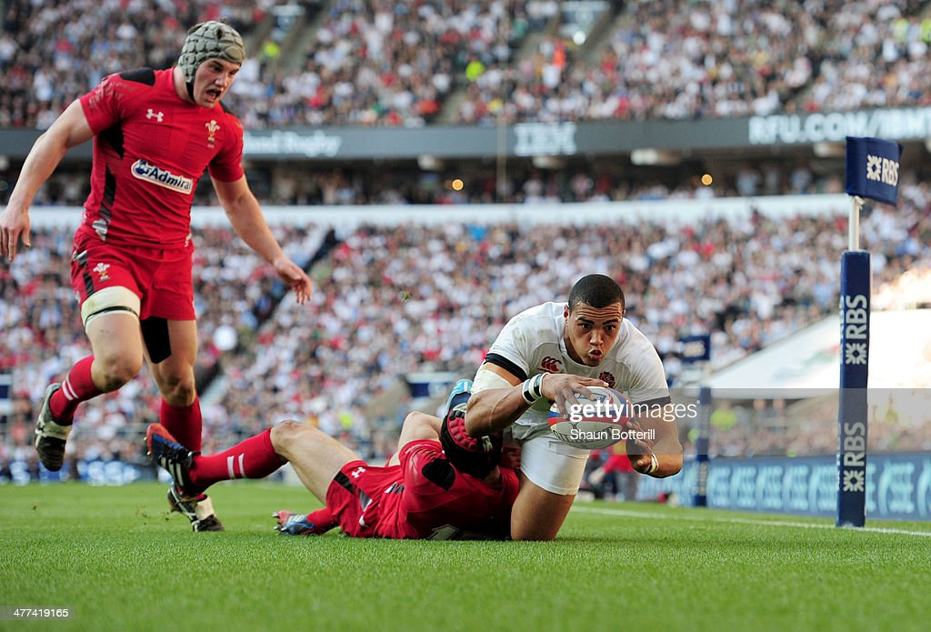 Luther Burrell of England beats Leigh Halfpenny of Wales to score their second try during the RBS Six Nations match between England and Wales at Twickenham Stadium on March 9, 2014 in London, England.