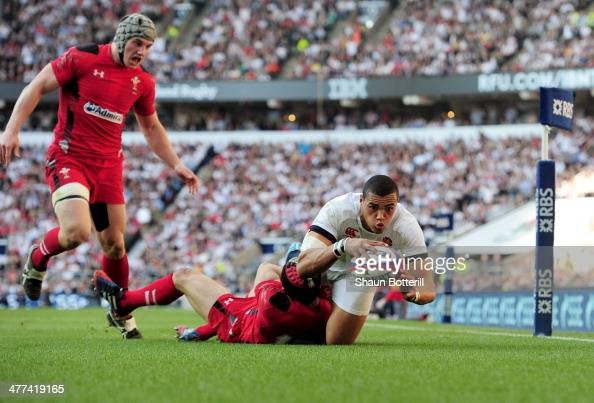 Luther Burrell of England beats Leigh Halfpenny of Wales to score their second try during the RBS Six Nations match between England and Wales at...