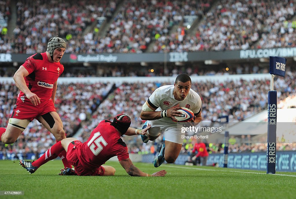 Luther Burrell of England beats the tackle of Leigh Halfpenny of Wales to score during RBS Six Nations match between England and Wales at Twickenham Stadium on March 9, 2014 in London, England.
