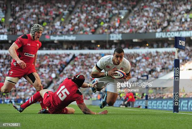 Luther Burrell of England beats the tackle of Leigh Halfpenny of Wales to score during RBS Six Nations match between England and Wales at Twickenham...