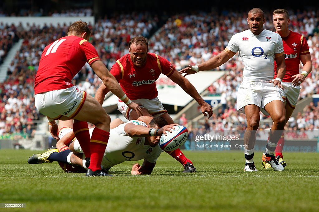 <a gi-track='captionPersonalityLinkClicked' href=/galleries/search?phrase=Luther+Burrell&family=editorial&specificpeople=871965 ng-click='$event.stopPropagation()'>Luther Burrell</a> of England dives over the scoreline for Englands first try of the match during the Old Mutual Wealth Cup between England and Wales at Twickenham Stadium on May 29, 2016 in London, England.