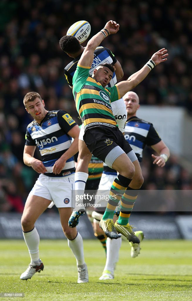 Luther Burrell of Northampton challenges Anthony Watson to the high ball during the Aviva Premiership match between Northampton Saints and Bath at Franklin's Gardens on April 30, 2016 in Northampton, England.