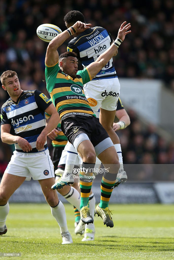 <a gi-track='captionPersonalityLinkClicked' href=/galleries/search?phrase=Luther+Burrell&family=editorial&specificpeople=871965 ng-click='$event.stopPropagation()'>Luther Burrell</a> of Northampton challenges Anthony Watson to the high ball during the Aviva Premiership match between Northampton Saints and Bath at Franklin's Gardens on April 30, 2016 in Northampton, England.