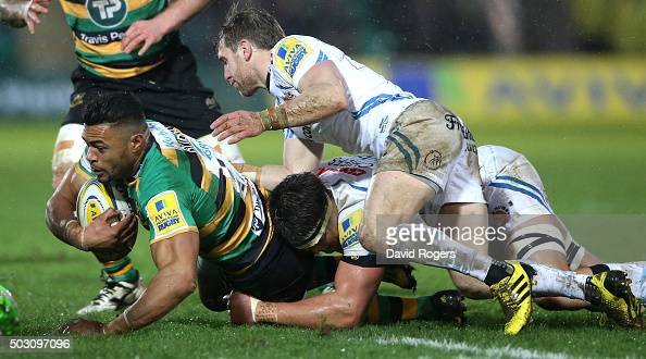 Luther Burrell of Northampton is stopped by Wil Chudley and Ollie Atkins during the Aviva Premiership match between Northampton Saints and Exeter...