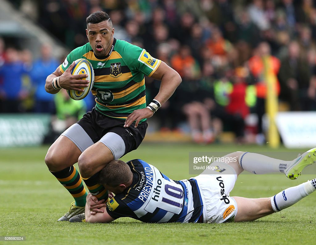 <a gi-track='captionPersonalityLinkClicked' href=/galleries/search?phrase=Luther+Burrell&family=editorial&specificpeople=871965 ng-click='$event.stopPropagation()'>Luther Burrell</a> of Northampton moves past <a gi-track='captionPersonalityLinkClicked' href=/galleries/search?phrase=Rhys+Priestland&family=editorial&specificpeople=4195648 ng-click='$event.stopPropagation()'>Rhys Priestland</a> during the Aviva Premiership match between Northampton Saints and Bath at Franklin's Gardens on April 30, 2016 in Northampton, England.