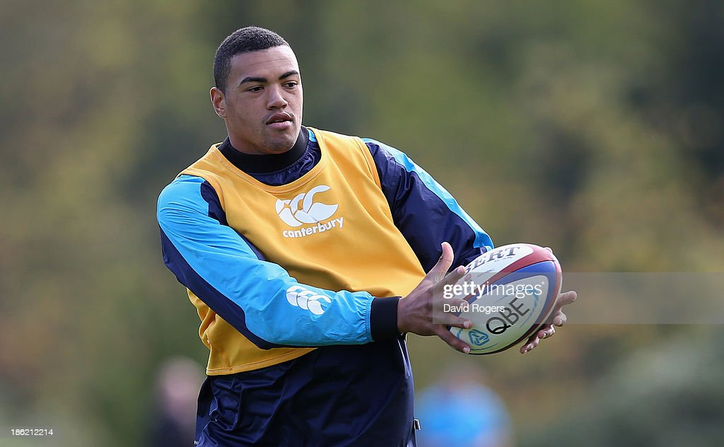 Luther Burrell passes the ball during the England training session held at Pennyhill Park on October 29, 2013 in Bagshot, England.