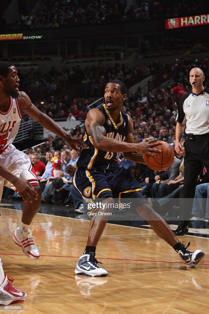 Luther Head of the Indiana Pacers handles the ball against John Salmons of the Chicago Bulls during the game on December 29 2009 at the United Center...
