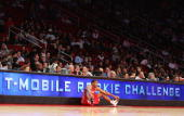 Luther Head of the Rookie Team sits and waits to enter the game against the Sophomore Team during the TMobile Rookie Challenge during NBA AllStar...