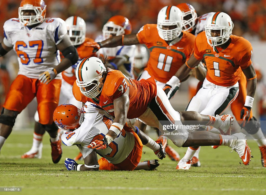 Luther Robinson #93 of the Miami Hurricanes tackles Jordan Jackson #34 of the Savannah State Tigers on September 21, 2013 at Sun Life Stadium in Miami Gardens, Florida. Miami defeated Savannah State 77-7.