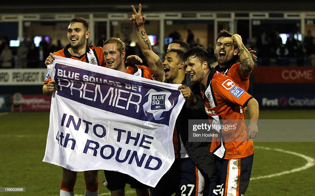 Luton players celebrate after winning the FA Cup with Budweiser Third Round match between Luton Town and Wolverhampton Wanderers at Kenilworth Road on January 5, 2013 in Luton, England.