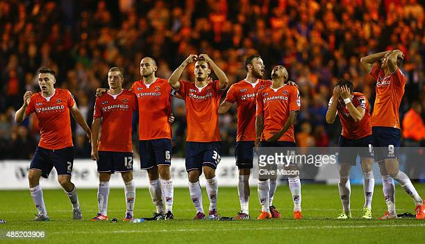 Luton players react during the penalty shootout during the Capital One Cup second round match between Luton Town and Stoke City at Kenilworth Road on...