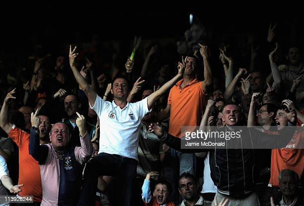 Luton Town fans taunt the Wrexham fans during the Blue Square Premier League play off semefinal second leg match between Luton Town and Wrexham at...