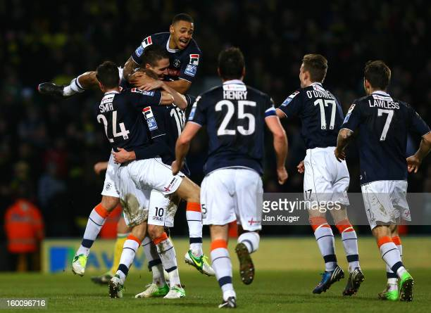 Luton Town players celebrate at the final whistle during the FA Cup with Budweiser fourth round match between Norwich City and Luton Town at Carrow...