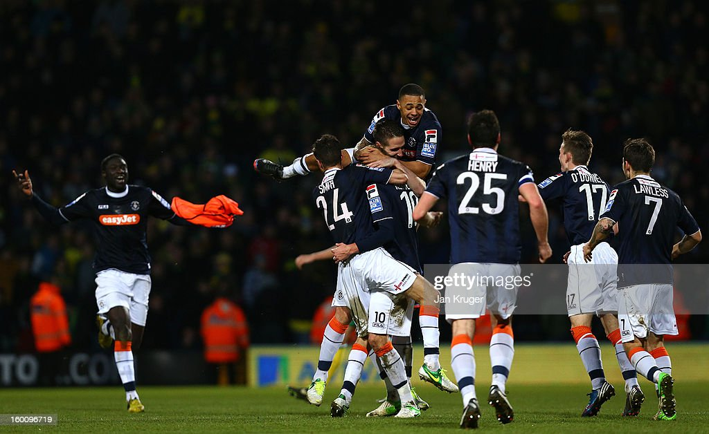 Luton Town players celebrate at the final whistle during the FA Cup with Budweiser fourth round match between Norwich City and Luton Town at Carrow Road on January 26, 2013 in Norwich, England.
