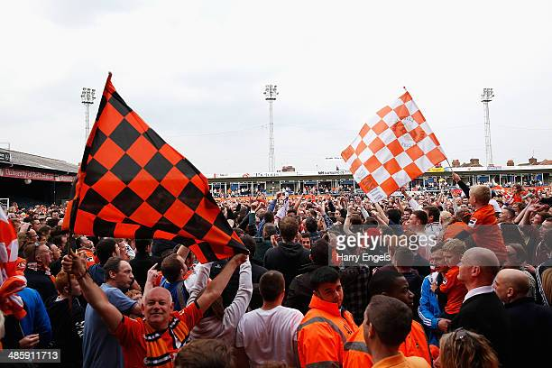 Luton Town supporters invade the pitch after their side won the Skrill Conference Premier match between Luton Town and Forest Green at Kenilworth...
