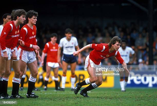 Luton Town v Manchester United Bryan Robson breaks from the United defensive wall