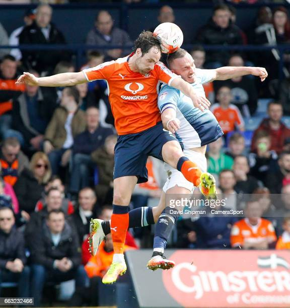 Luton Town's Danny Hylton battles with Blackpool's Tom Aldred during the Sky Bet League Two match between Luton Town and Blackpool at Kenilworth Road...