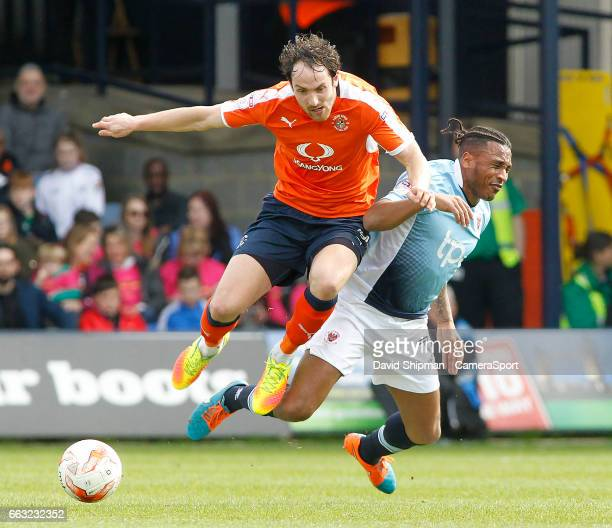Luton Town's Danny Hylton gets away from Blackpool's Neil Danns during the Sky Bet League Two match between Luton Town and Blackpool at Kenilworth...