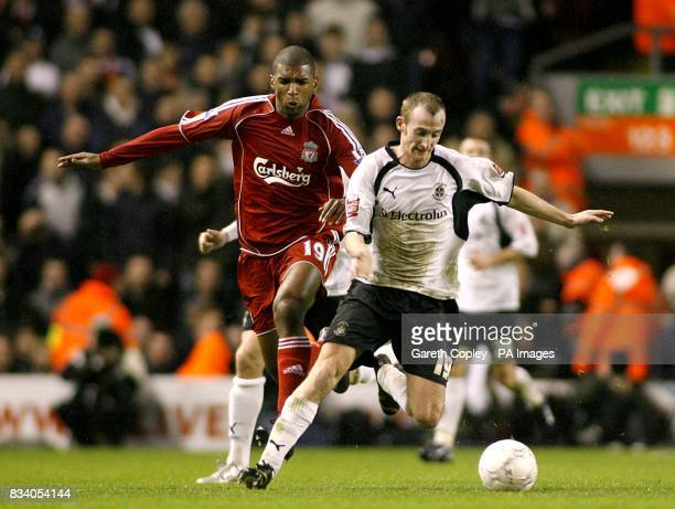 Luton Town's Drew Talbot and Liverpool's Ryan Babel