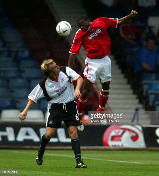 Luton Town's Paul Underwood and Charlton Athletic's Osei Sankofa battle for the ball