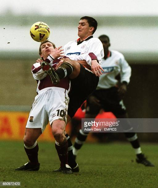 Luton Town's Richard Dryden and Northampton's Marco Gabbiadini battle for the ball