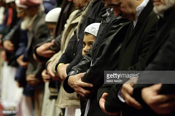 A small boy prays with other Muslims during the EidalAdha Festival of the Sacrifice marking the end of the Hajj pilgrimage in Luton's Central Mosque...