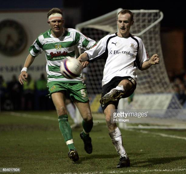 Luton's Drew Talbot is challenged by Yeovil's Scott Guyett during the CocaCola Football League One match at Kenilworth Road Luton