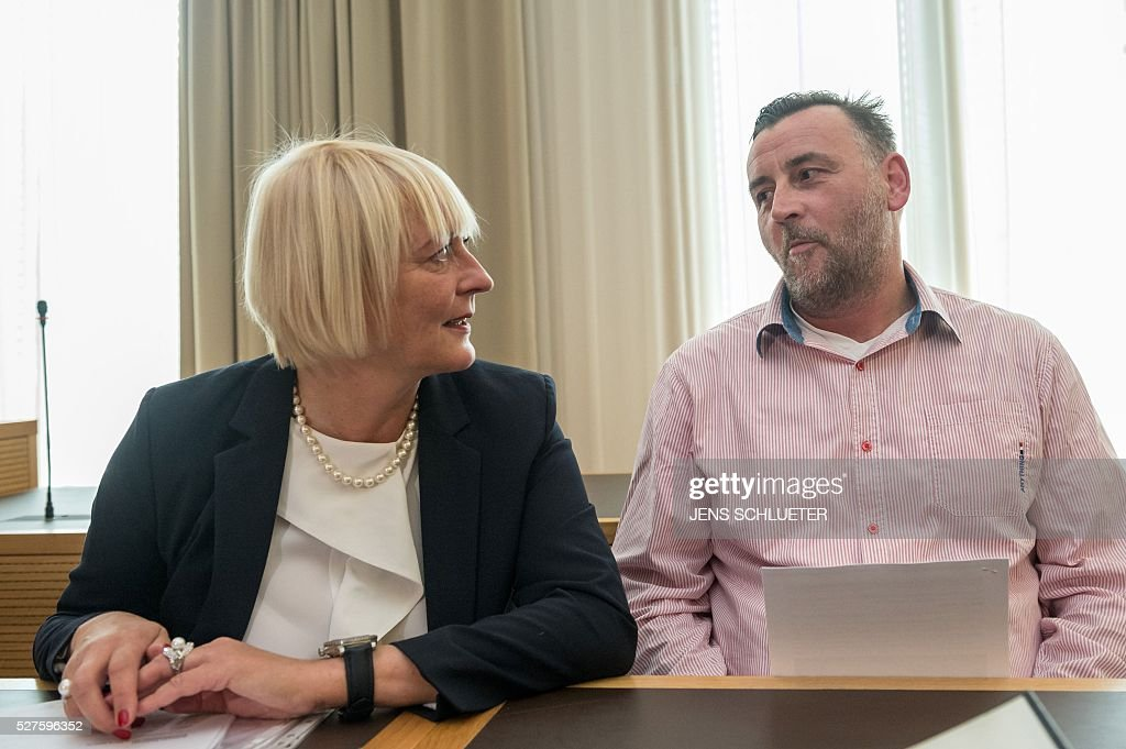 Lutz Bachmann (R), co-founder of Germany's xenophobic and anti-Islamic PEGIDA movement (Patriotic Europeans Against the Islamisation of the Occident), sits next to his lawyer his lawyer Katja Reichel as he waits for the continuation of his trial on May 3, 2016 in Dresden, eastern Germany. Bachmann has to appear in court on hate speech charges for branding refugees 'cattle' and 'scum' on social media. He was charged in October 2015 with inciting racial hatred through a series of widely-shared Facebook posts. / AFP / POOL / Jens Schlueter