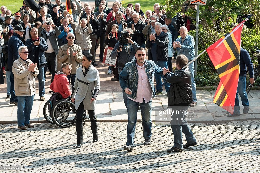 Lutz Bachmann (C), co-founder of Germany's xenophobic and anti-Islamic PEGIDA movement (Patriotic Europeans Against the Islamisation of the Occident) and his wife Vicky Bachmann (Center L) arrive for the continuation of his trial on May 3, 2016 in Dresden, eastern Germany. Bachmann has to appear in court on hate speech charges for branding refugees 'cattle' and 'scum' on social media. He was charged in October 2015 with inciting racial hatred through a series of widely-shared Facebook posts. / AFP / dpa / Jens Schlueter / Germany OUT