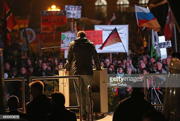 Lutz Bachmann cofounder of the Pegida movement speaks to supporters gathered at Theaterplatz square on the first anniversary since the first Pegida...