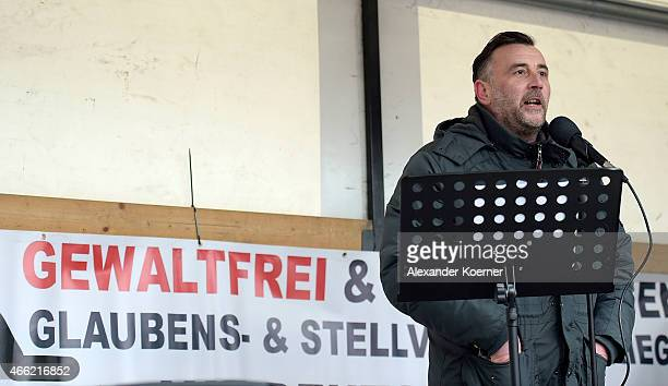 Lutz Bachmann Head of Pegida speaks to supporters at a public gathering on March 14 2015 in Wuppertal Germany Several hundred Salafis who in Germany...