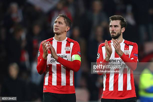 Luuk de Jong and Davy Proepper of PSV Eindhoven applaud the crowd after the UEFA Champions League Group D match between PSV Eindhoven and FC Bayern...